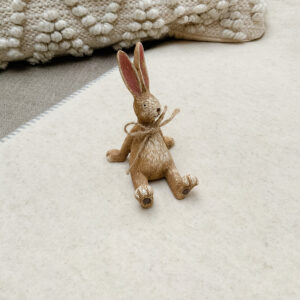 Relaxed rabbit with jute ribbon